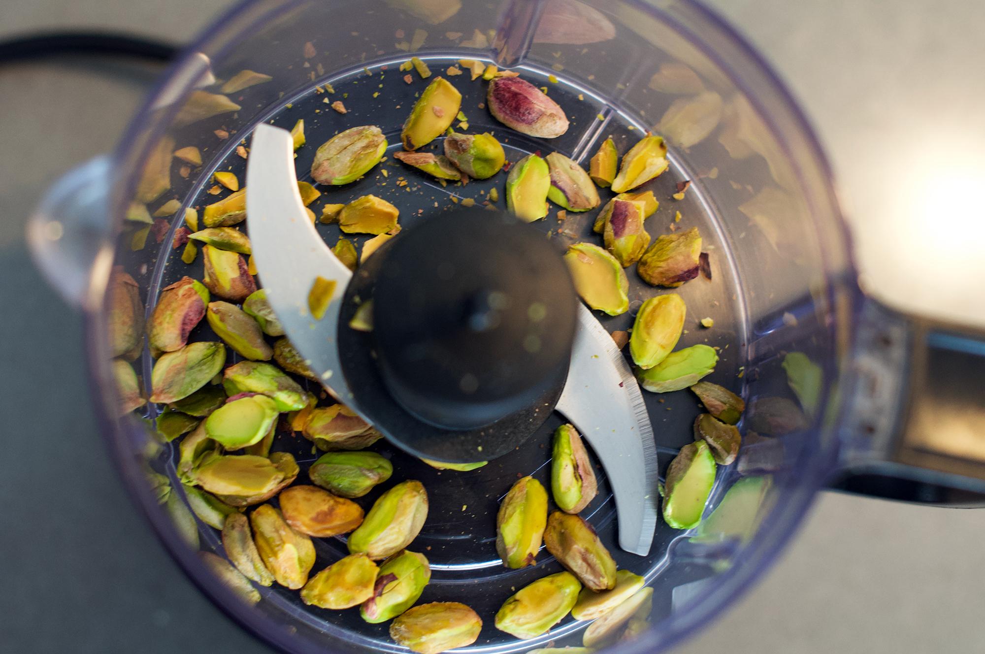 Chopped pistachio kernels in mini chopper food processor KitchenAid