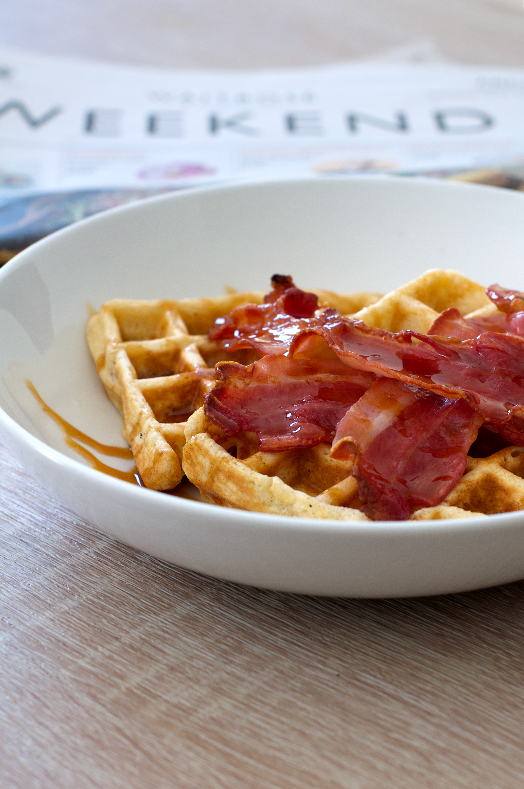 Recipe for breakfast waffles with crispy bacon and syrup