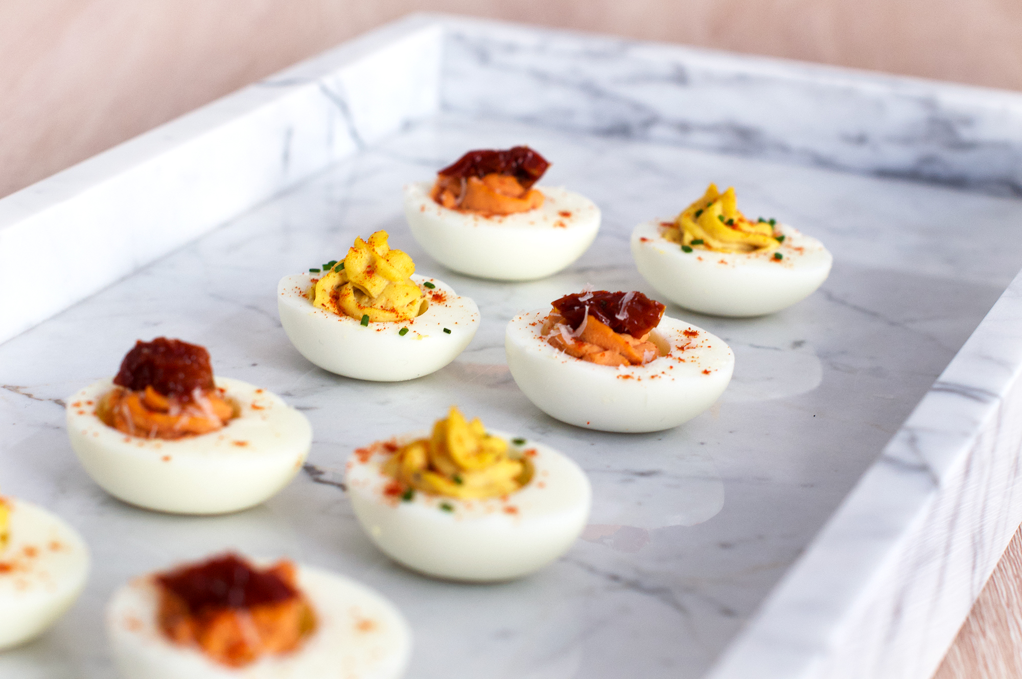 Recipe for classic devilled eggs and tomato and pecorino devilled eggs
