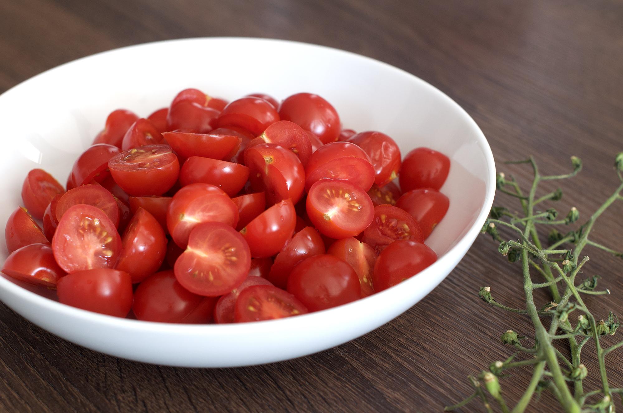 Halved cherry tomatoes on the vine