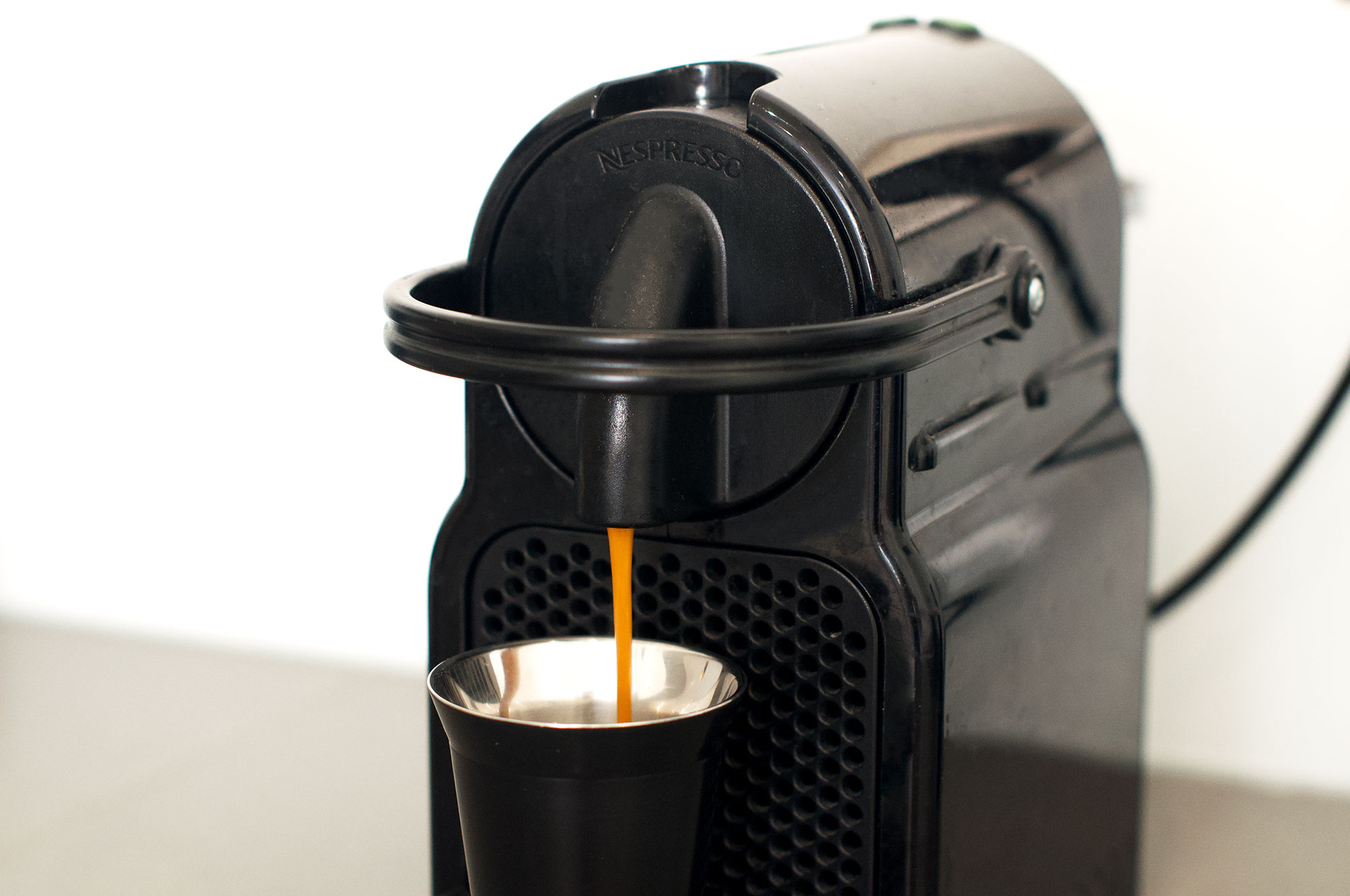 Nespresso Inissia machine pouring espresso cup using 'palermo' capsule