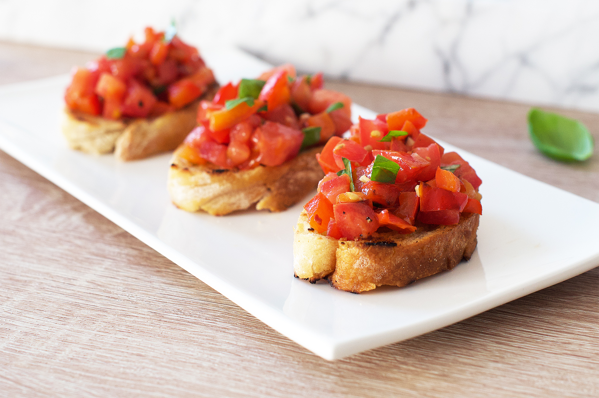Spicy tomato and red pepper bruschetta with basil recipe
